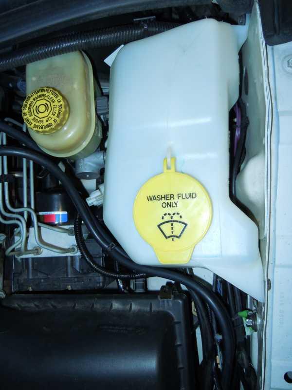 265 70r17 All Terrain Tires >> windshield reservoir move? - JeepForum.com